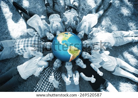 Earth against happy friends in the park lying in circle - stock photo