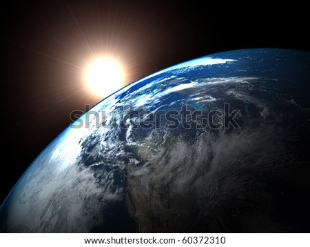 Earth and the rising Sun - stock photo