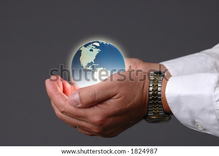 Earth being held in hands with a neutral background - stock photo