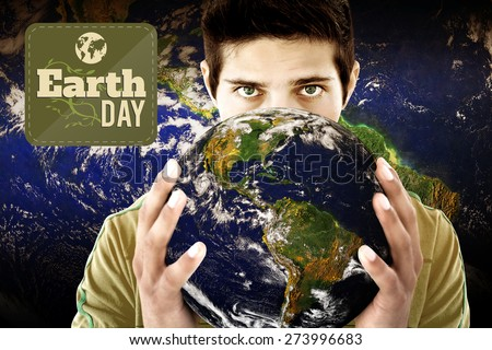 Earth Day Graphic against man holding earth - stock photo