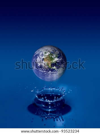 Earth globe floats on crystal clear water ripples. Earth Map courtesy of NASA - stock photo