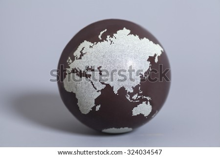 Earth Globe on gray background - stock photo