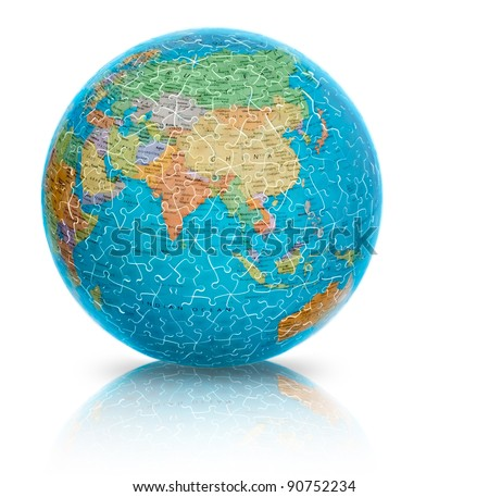 Earth globe puzzle illuminated from inside showing Asia isolated on white reflected. Based on 2005 COLUMBUS Verlag Globe. Paul Oestergaard, Germany - stock photo