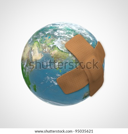Earth globe with a band aid - nature conservation concept - stock photo