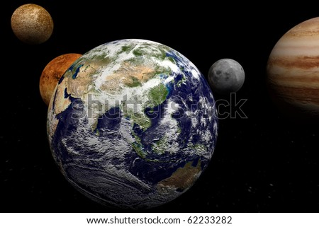 Earth in front of planets - stock photo