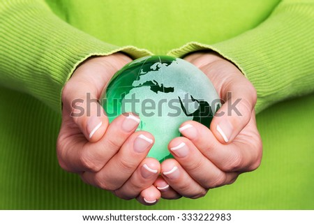 Earth in hands, environment concept, Europe, blue background - stock photo
