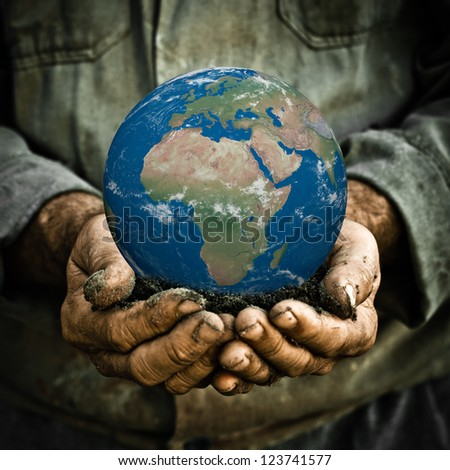 Earth in hands of old man. Ecology concept - stock photo