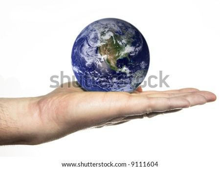 earth in palm of hand - stock photo