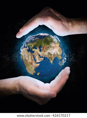 earth in space. planet in the hands - stock photo