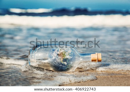 Earth in the bottle coming with wave from ocean. Concept of environment, nature care, save clean world message. Elements of this image furnished by NASA - stock photo