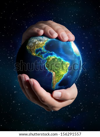 earth in the hands - Universe background - USA  - stock photo
