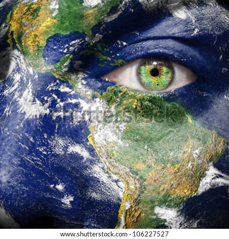 Earth painted on face to draw attention for a green and to create awareness for climate change - Elements of this image furnished by NASA - stock photo