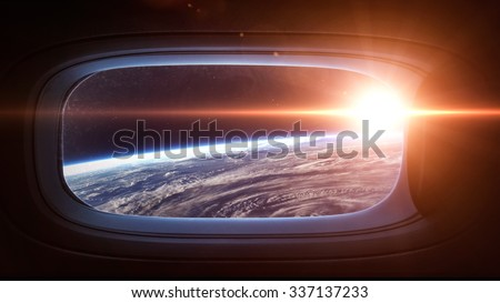 Earth planet in space ship window porthole. Elements of this image furnished by NASA. - stock photo