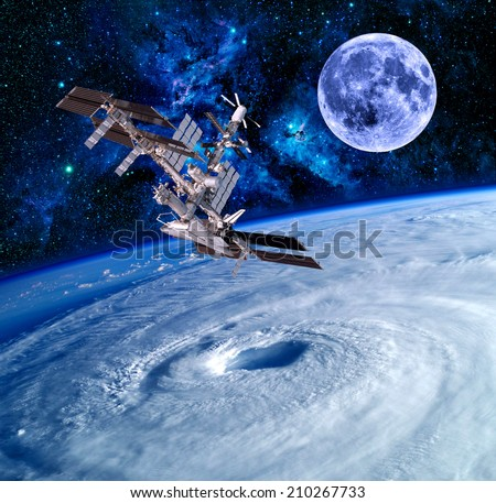 Earth satellite space station spaceship sky stars. Elements of this image furnished by NASA. - stock photo