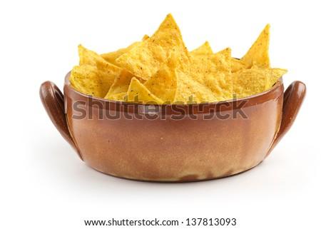 earthenware bowl full of nachos on white background - stock photo