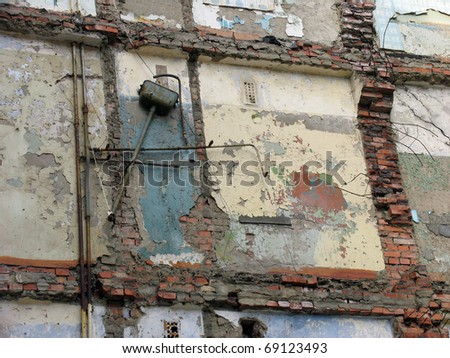 Earthquake  terrorist act terror terrorism  The Wall of ruinous building. - stock photo