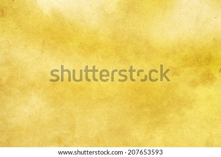 Earthy grunge background on gold background with space for text or image. - stock photo
