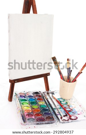 Easel and paints - stock photo