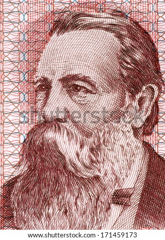 EAST GERMANY - CIRCA 1951: Friedrich Engels (1820-1895) on 50 Marks 1951 Banknote from East Germany. German social scientist, author, political theorist and philosopher. - stock photo