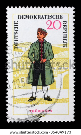 EAST GERMANY (DDR) - CIRCA 1966: A stamp printed in East Germany shows regional costume of Thuringen. East Germany, circa 1966 - stock photo