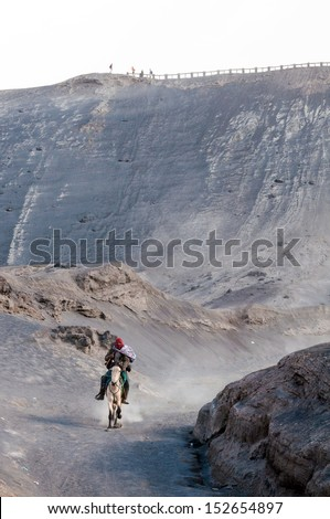 EAST JAVA, INDONESIA-MAY 05 : Horseman at Mount Bromo, The active volcano is one of the most visited tourist attractions on May 05,2013 in East Java, Indonesia - stock photo