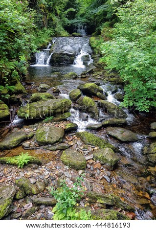 East Lyn River, Lynmouth, Exmoor, Devon, England. Showing the cascading water over the rocks. - stock photo