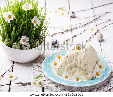 Easter ,a Traditional Russian Orthodox Easter Desserts, cottage cheese and cream.Decorated with green grass and flowers and quail eggs.selective focus - stock photo