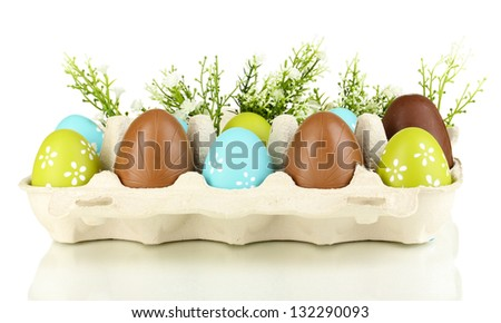 Easter and chocolate eggs in paper box for them isolated on white - stock photo