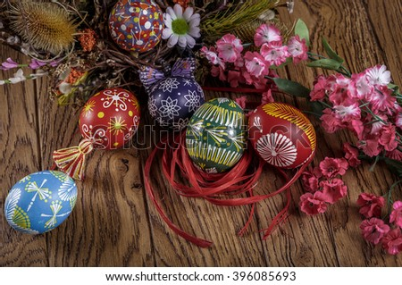 Easter background. colored Easter eggs and composition of dried flowers and plants. on wooden background. easter theme. happy easter - stock photo