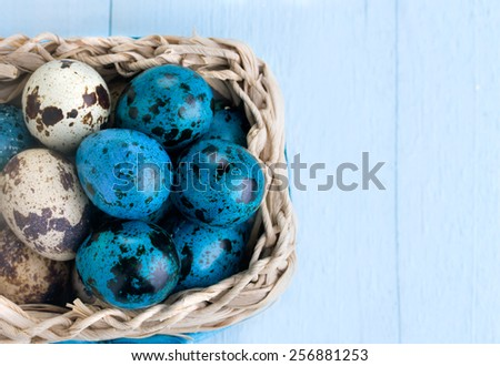 Easter background. Colorful easter eggs in white basket - stock photo
