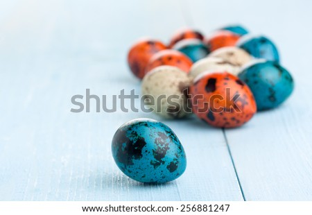Easter background. Colorful easter eggs on wooden background. - stock photo