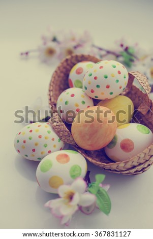 easter background with eggs and flowers - stock photo