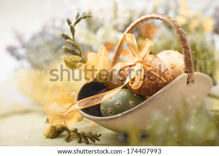 Easter background with eggs and spring flowers, shallow DOF, text space  - stock photo
