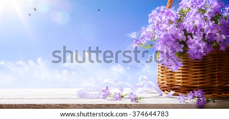 Easter background with spring flowers a  blue sky background - stock photo
