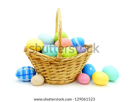 Easter basket with colorful eggs over white - stock photo
