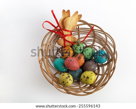 Easter basket with cookies in the form of rabbits and quail eggs. Top view. - stock photo