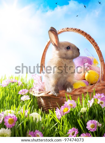 Easter basket with decorated eggs and the Easter bunny - stock photo