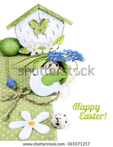Easter border with blue grape hyacinth and green decorations isolated on white.  - stock photo