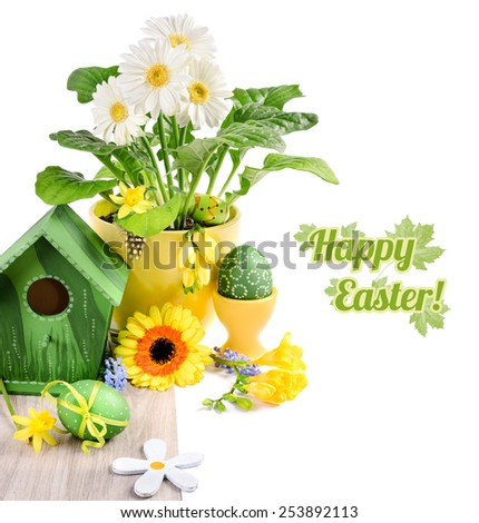 Easter border with spring flowers and handmade decorations on wooden table, isolated on white, space for your text - stock photo