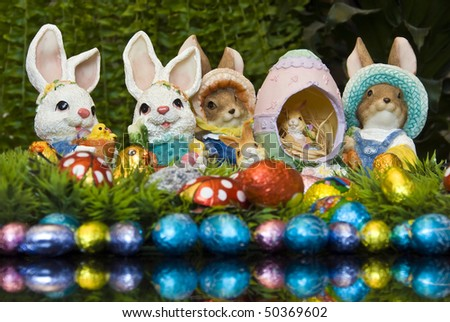 Easter bunnies and chocolate Easter eggs as decoration - stock photo
