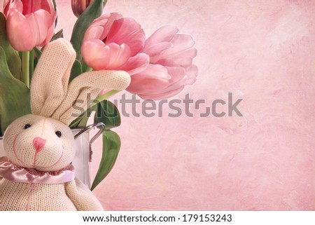 Easter bunny and tulips on pink background - stock photo
