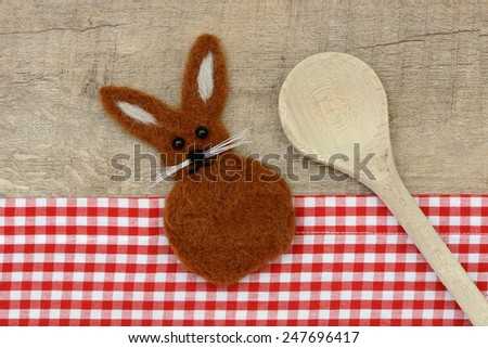 Easter bunny and wooden spoon - stock photo
