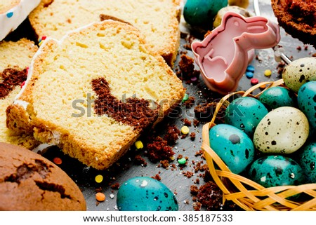 Easter bunny cake and colorful eggs on festive Easter table selective focus - stock photo