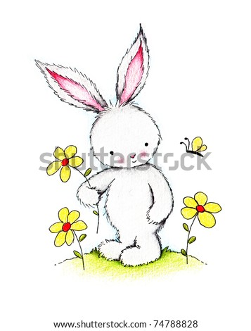 Easter bunny holding yellow flower on green lawn - stock photo