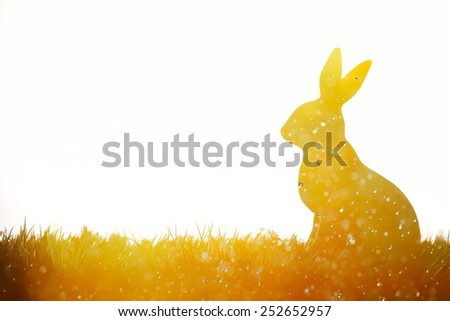 Easter bunny on meadow,Multi exposure. - stock photo