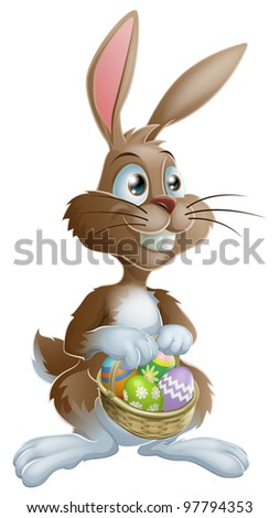 Easter bunny rabbit holding Easter basket full of decorated Easter eggs - stock photo