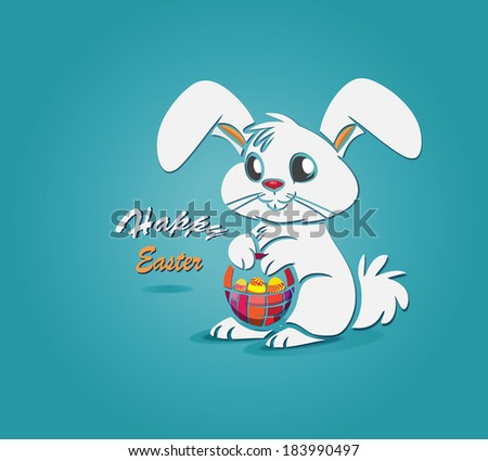 Easter bunny rabbit with an Easter eggs  basket - stock photo