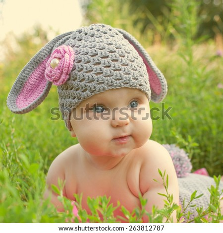 Easter bunny sweet baby in green grass - stock photo