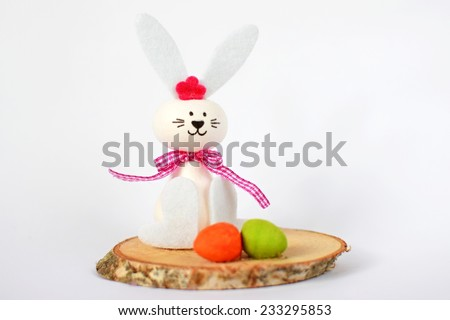Easter Bunny with eggs on a clean white background - stock photo