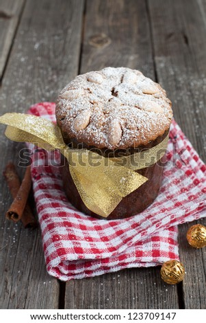 Easter cake, panettone on the wooden table with red kitchen towel - stock photo